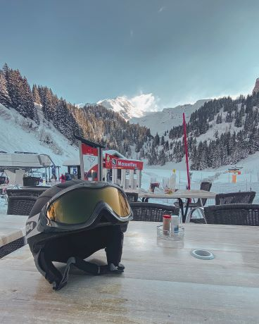 Ski Goggles on helmet with mountain background